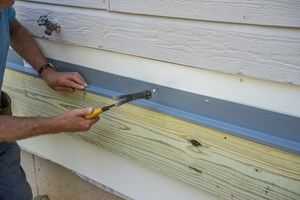 Decks Com Ledger Board Installation Attachment And Flashing