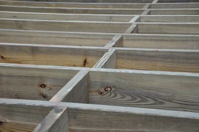 Reinforcing deck rim or band joists for Wood floor joist spacing