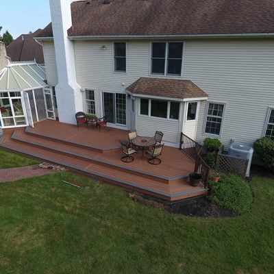 Tiki torch deck with island mist boards and bronze trex reveal railings - Picture 7525