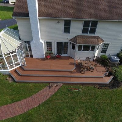 Tiki torch deck with island mist boards and bronze trex reveal railings - Picture 7526