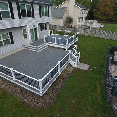 Island mist trex deck with white vinyl rails - Picture 7544