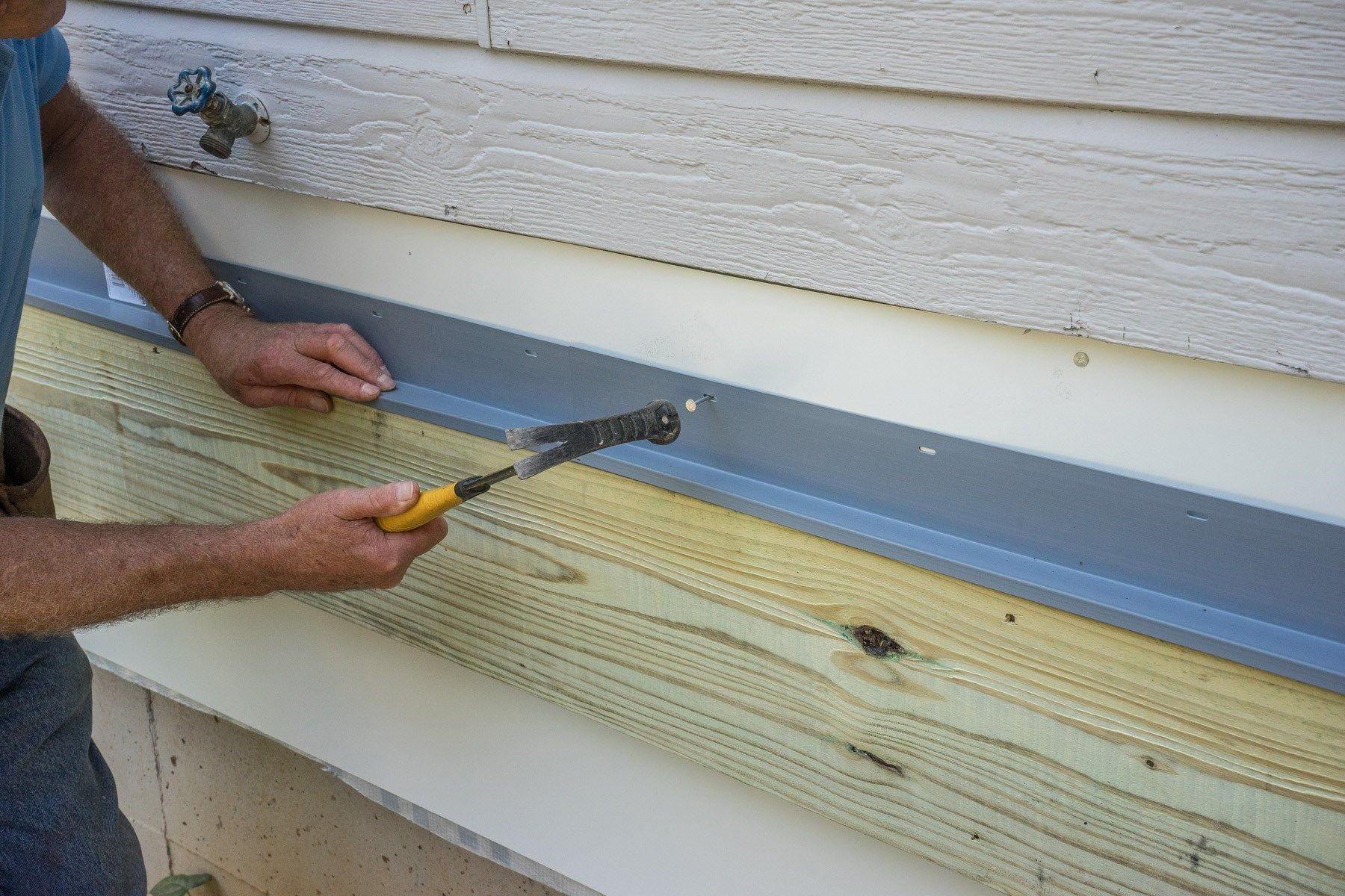 Attaching deck to house with siding - Flashing The Ledger Board