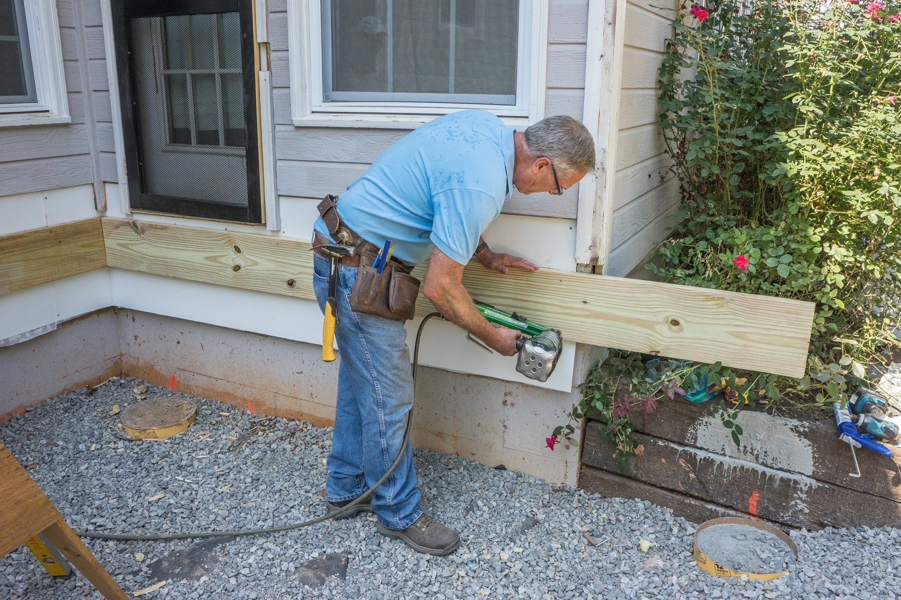 How to build a deck attaching the ledger board for What goes into building a house