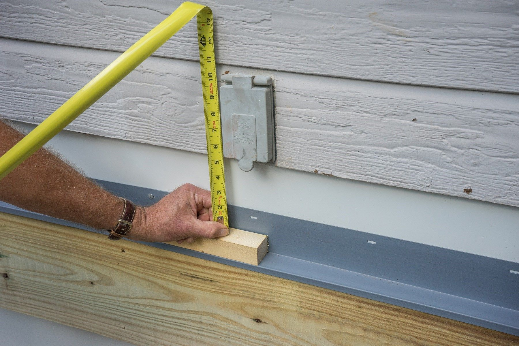 Attaching deck to house with siding - How To Build A Deck Attaching The Ledger Board