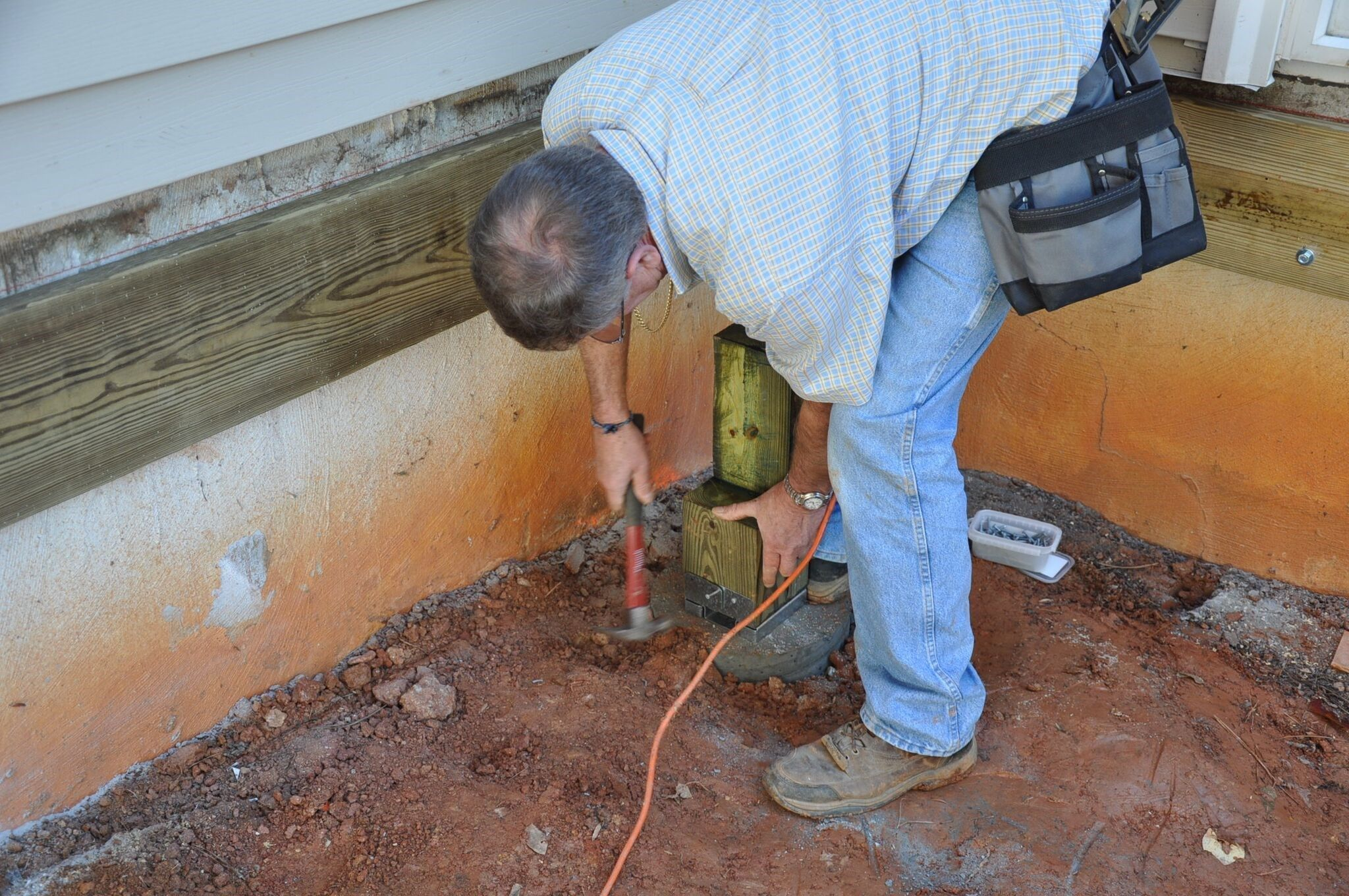 How To Attach Deck Post Bases To Concrete Footers Decks Com
