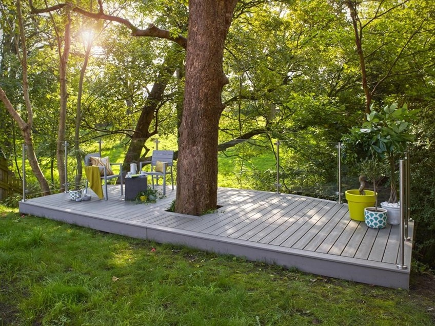 Wide shot of composite deck with tree