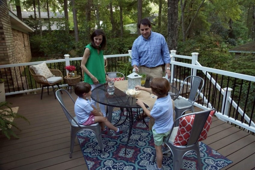 Family enjoying back deck