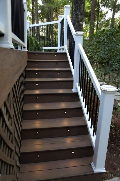 Brown, lit, composite stairs with white railing