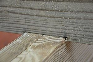 Using Shims to Level the Deck Surface | Decks com