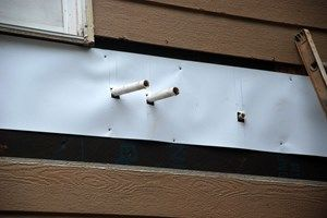 Installing a Deck Ledger Board Around Vents, Pipes and Spigots