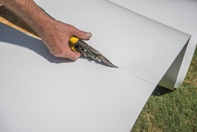 Cut the flashing with tin snips