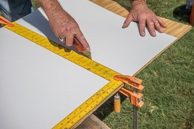 Score with a utility knife. Do not cut all the way through.