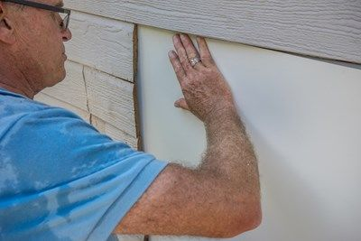 Slip flashing under siding
