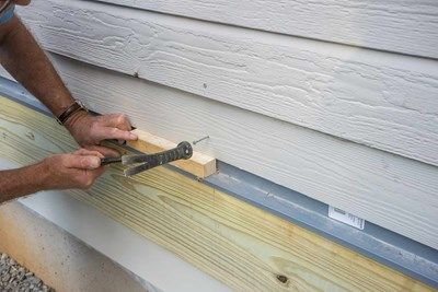 "Use 1-1/4"" thick board to hold the siding at proper height."