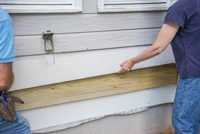 Slip the siding board behind above siding.