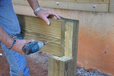 Screw the first piece of the beam to the notched post.