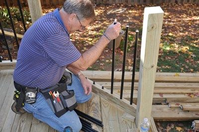 Attaching the aluminum balusters.