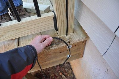 Tuck the wires under the deck.