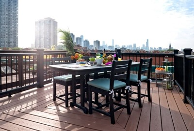Outdoor rooftop dining area with garden decor