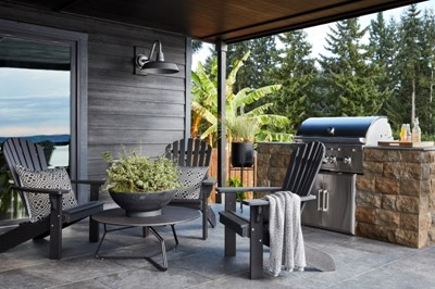 Small outdoor kitchen with a grill and seating for three