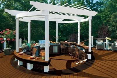 Small outdoor summer kitchen design under a pergola