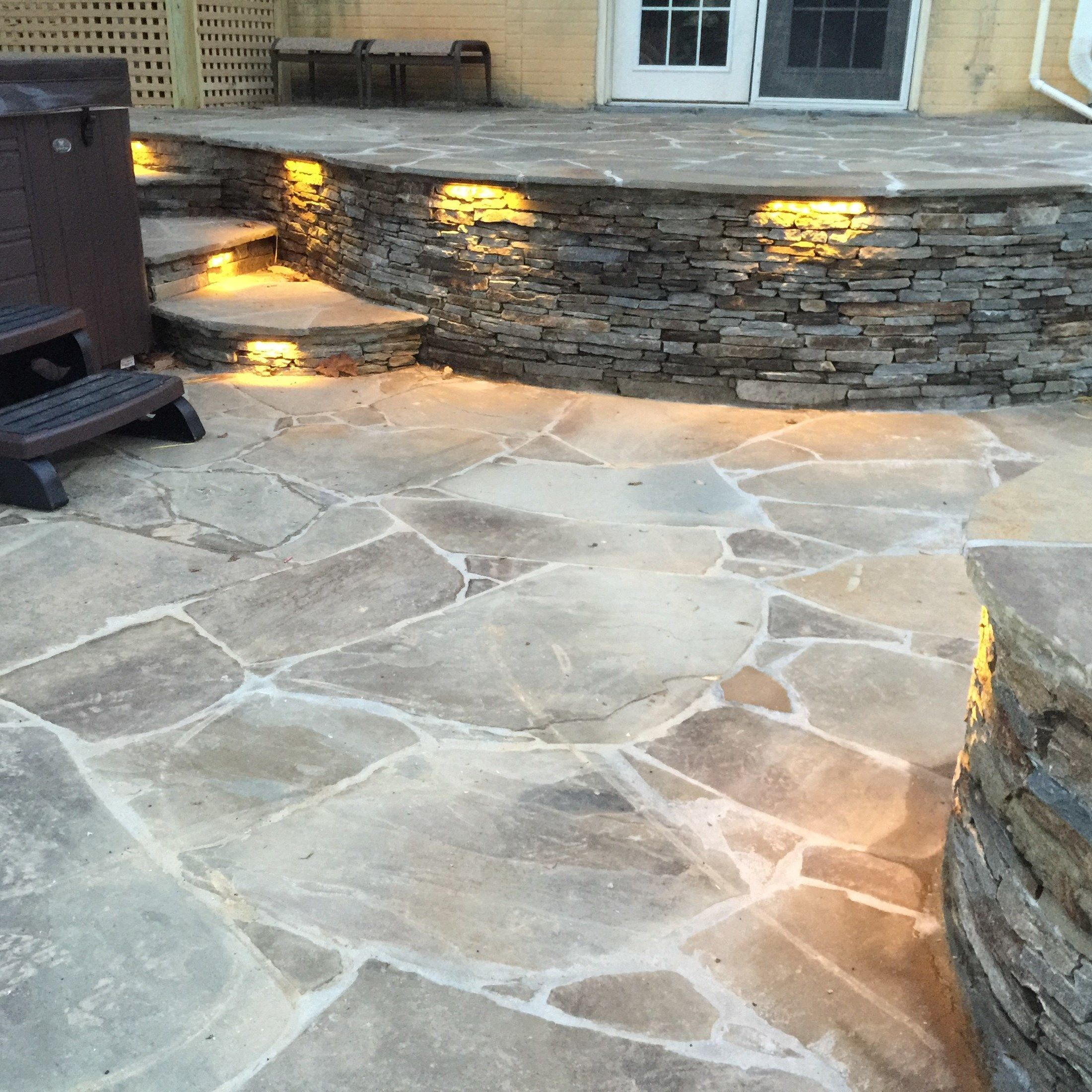 Flagstone patio with Hot tub. - Picture 2025