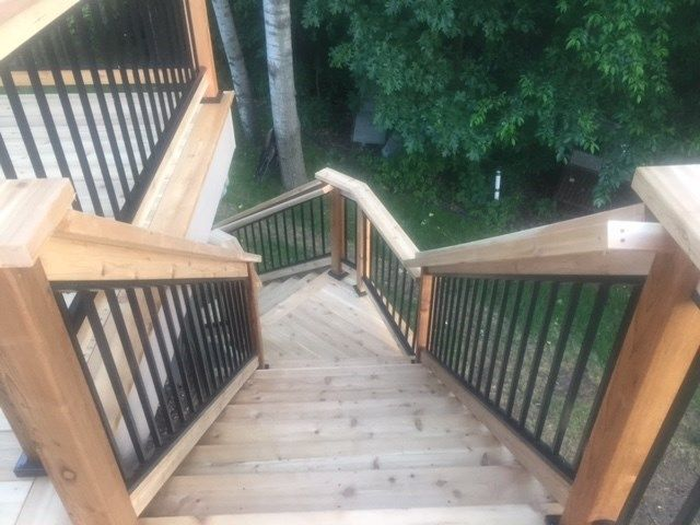 Cedar deck with aluminum baluster railings. - Picture 7217