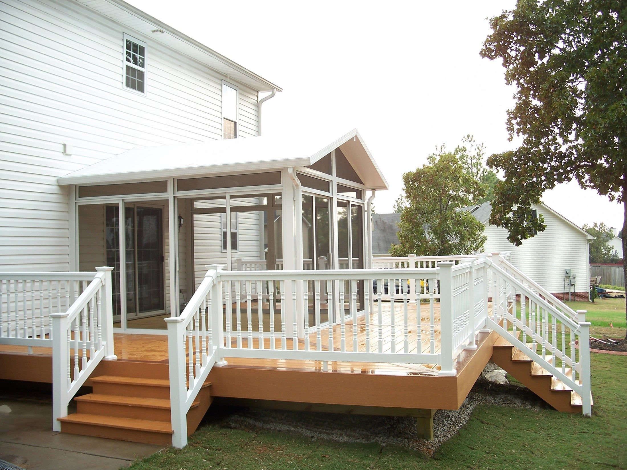 Attaching deck to house with siding - 2 Pictures