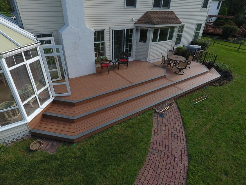 Tiki torch deck with island mist boards and bronze trex reveal railings - Picture 7528